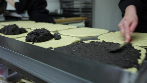Pastry cook backing Poppy-Seed - Stollen Stock Video Footage