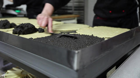Pastry cook backing Poppy-Seed - Stollen Footage