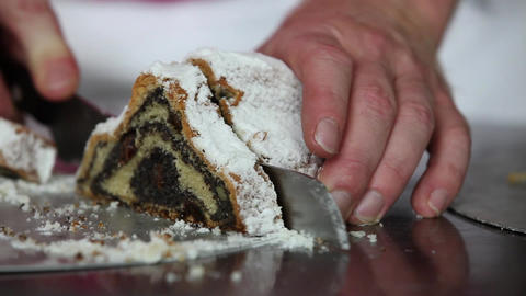 Baker cutting delicious Poppy-Seed-Stollen Footage