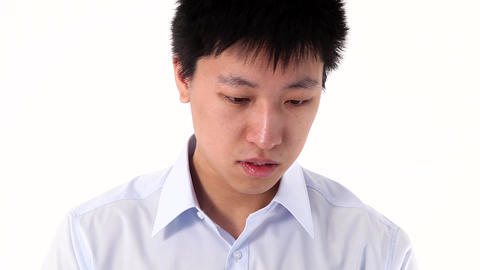 Young Asian man talking on smartphone, closeup Stock Video Footage