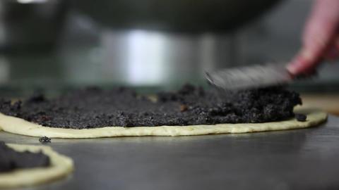 Baker filling in Poppy-Seed-Stollen Stock Video Footage