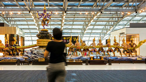 Travelers in Bangkok Suvarnabhumi Airport - Timela Stock Video Footage