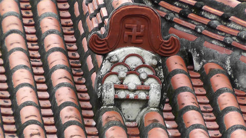 Buddhist Swastika on top a Buddhist Temple in Japan Stock Video Footage