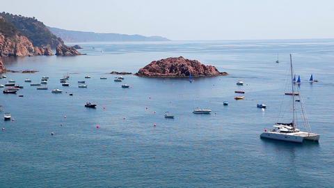 Seashore of Tossa de Mar, boats and catamaran, Costa... Stock Video Footage
