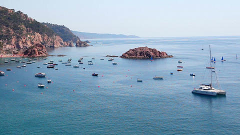 Seashore of Tossa de Mar, boats and catamaran, Costa... Stock Video Footage