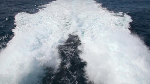 Waves behind fast motorboat Stock Video Footage