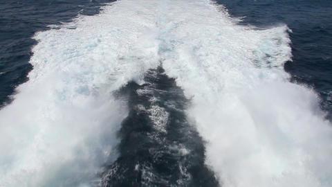 Waves behind fast motorboat Footage