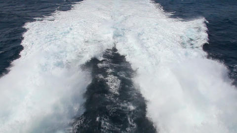 Waves behind fast motorboat Stock Video Footage