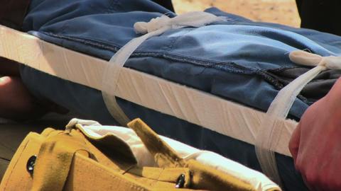 Paramedics immobilize victim's leg Stock Video Footage