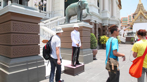 Visitors with soldier in Grand Palace, Bangkok, Thailand Stock Video Footage