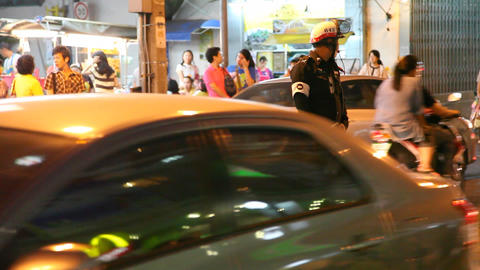 Policeman on night street in Bangkok Stock Video Footage