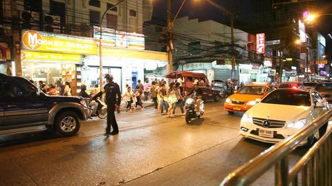 Policeman on night street in Bangkok Stock Video Footage