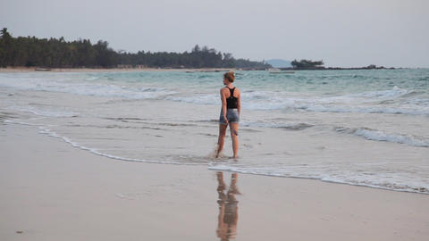 Young woman walk Ngapali beach sunset, Myanmar Stock Video Footage