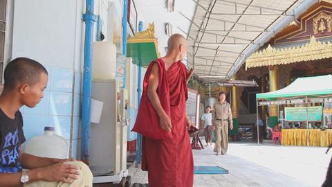 Buddhist monk drink water in Sule Pagoda Footage