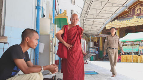 Buddhist monk drink water in Sule Pagoda Stock Video Footage
