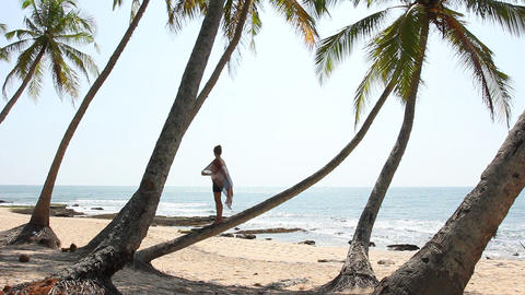 Woman Stand on palm tree Stock Video Footage