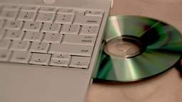 Insert CD into Laptop Stock Video Footage