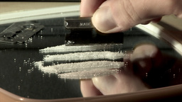 Arranging Cocaine Into Four Lines Using Razor Blade (High... Stock Video Footage