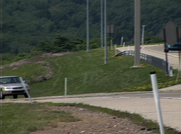Fast-Moving Vehicles On Uphill Road Stock Video Footage