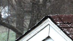Snow falling on rooftop Stock Video Footage