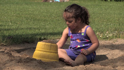 Girl playing with sand Footage