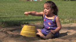 Girl playing with sand Stock Video Footage