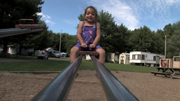 Girl on see-saw Stock Video Footage