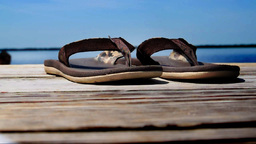 Sandals on a dock. Shallow DOF Stock Video Footage