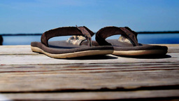 Sandals on a dock. Shallow DOF Footage