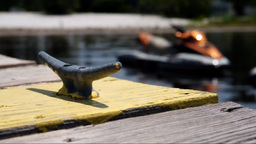 A jet ski docked on a lake. Shallow DOF Stock Video Footage