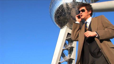 Wide shot of businessman on mobile Stock Video Footage