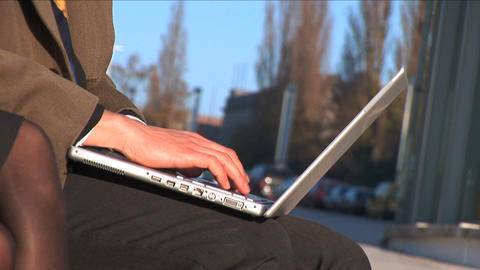 Close up of business couple on the laptop outside Stock Video Footage