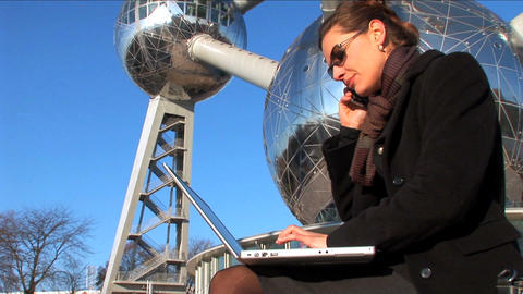 Wide shot businesswoman on laptop and mobile Stock Video Footage