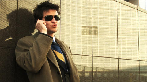 Businessman on mobile in city Stock Video Footage