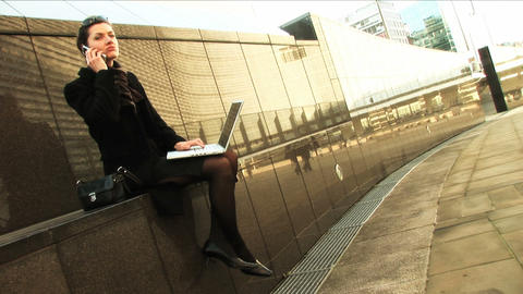 Businesswoman on laptop and mobile Footage