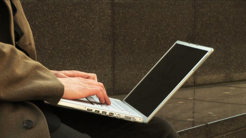 Businessman on laptop in city Footage