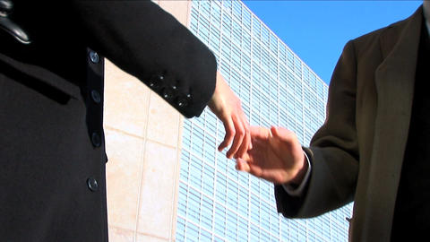 Business couple in city meeting handshake, close up Footage