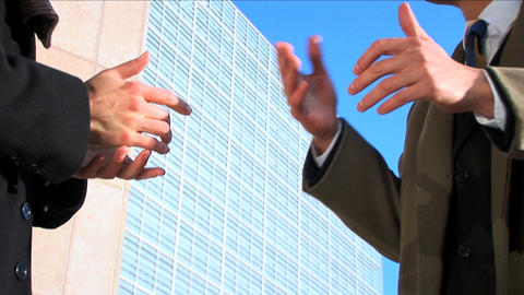 Business couple in city meeting hands, close up Footage