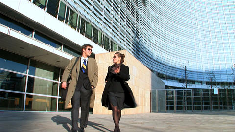 Business couple in city leaving the office Stock Video Footage
