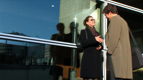 Business couple in city meeting outside office Stock Video Footage