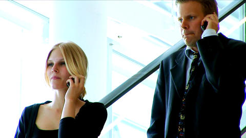Businessman and woman using a mobile phone Stock Video Footage