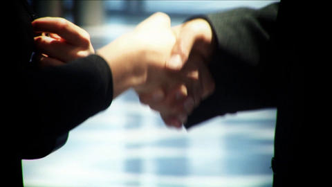 Businessman and woman shaking hands on a deal together Stock Video Footage