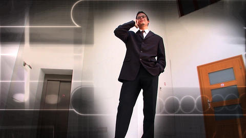 Young businessman using a mobile phone with a background... Stock Video Footage