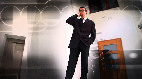 Young businessman using a mobile phone with a background of moving business images Footage