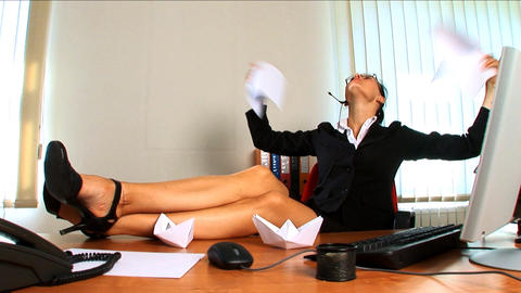 Young business woman feeling the heat Stock Video Footage