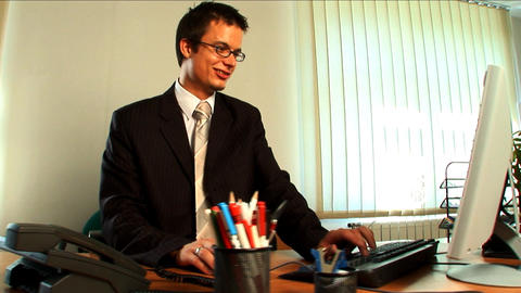 Young businessman in modern working environment Footage