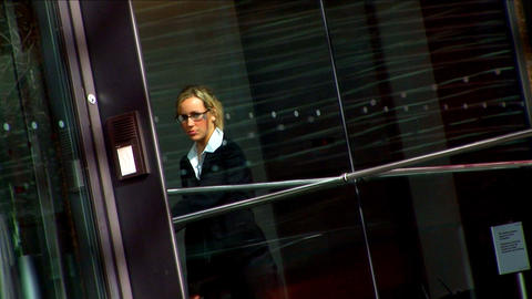 Attractive businesswoman in city leaving the office Footage