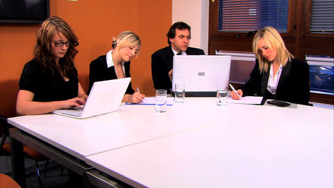 Ambitious business people using technology in the office... Stock Video Footage