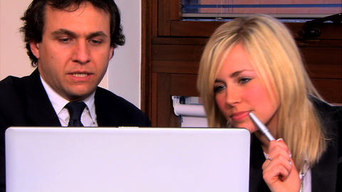 Businessman and assistant working at the office Footage