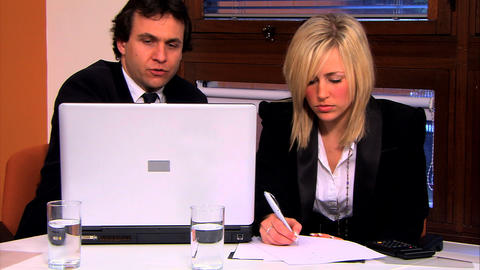 Businessman and assistant working at the office Stock Video Footage
